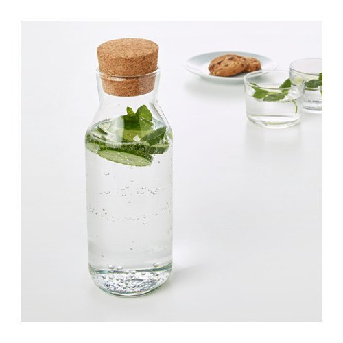decoración de mesas de verano con botellas de cristal