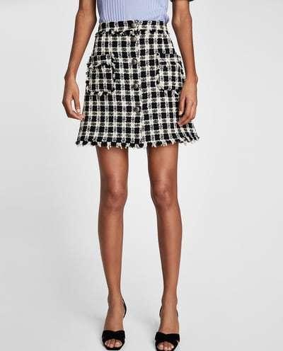 vestir como una it girl con falda de cuadros